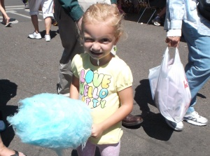 Some cotton candy having its way with my young cousin, Phoenix